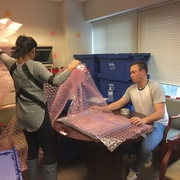 Students assist professors and programs with packing